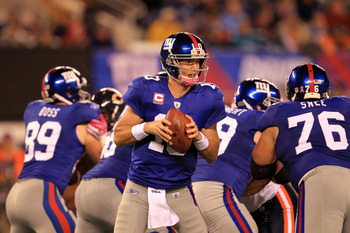 EAST RUTHERFORD, NJ - OCTOBER 03:  Eli Manning #10 of the New York Giants drops back against the Chicago Bears at New Meadowlands Stadium on October 3, 2010 in East Rutherford, New Jersey.  (Photo by Chris McGrath/Getty Images)