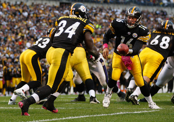 PITTSBURGH - OCTOBER 03:  Charlie Batch #16 of the Pittsburgh Steelers hands the ball off to Rashard Mendenhall #34 during the game against the Baltimore Ravens on October 3, 2010 at Heinz Field in Pittsburgh, Pennsylvania.  (Photo by Jared Wickerham/Gett