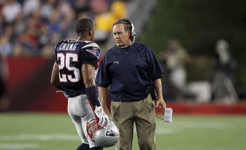 FOXBORO, MA - AUGUST 12: Patrick Chung # 25 and Coach Bill Belichick of the New England Patriots talk during the preseason game against the New Orleans Saints at Gillette Stadium on August 12, 2010 in Foxboro, Massachusetts. (Photo by Jim Rogash/Getty Ima