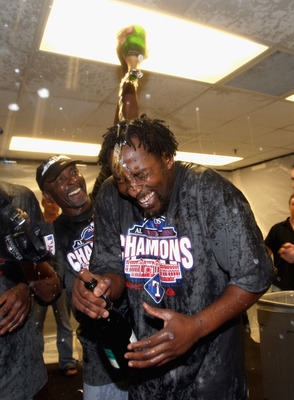 OAKLAND, CA - SEPTEMBER 25:  Vladimir Guerrero #27 of the Texas Rangers is covered in champagne by Gary Pettis after they beat the Oakland Athletics to clinch the American League West Title at the Oakland-Alameda County Coliseum on September 25, 2010 in O