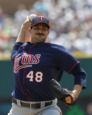 DETROIT - JULY 11: Carl Pavano #48 of the Minnesota Twins pitches in the first inning during the game against the Detroit Tigers on July 11, 2010 at Comerica Park in Detroit, Michigan.  (Photo by Leon Halip/Getty Images)