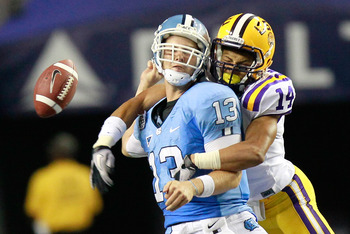 ATLANTA - SEPTEMBER 04:  Tyrann Mathieu #14 of the LSU Tigers forces a fumble by quarterback T.J. Yates #13 of the North Carolina Tar Heels during the Chick-fil-A Kickoff Game at Georgia Dome on September 4, 2010 in Atlanta, Georgia.  (Photo by Kevin C. C