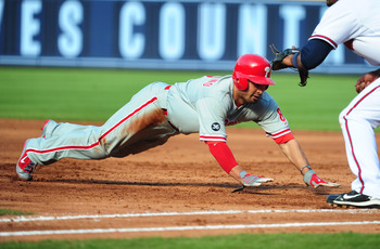 ATLANTA - OCTOBER 2: Shane Victorino #8 of the Philadelphia Phillies dives back to first base against the Atlanta Braves at Turner Field on October 2, 2010 in Atlanta, Georgia.  (Photo by Scott Cunningham/Getty Images)