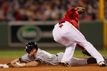 BOSTON - OCTOBER 2:  Brett Gardner #11 of the New York Yankees steals second as Felipe Lopez #32 of the Boston Red Sox covers second base during the first game of a doubleheader at Fenway Park October 2, 2010 in Boston, Massachusetts. (Photo by Jim Rogash