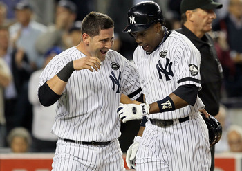 NEW YORK - SEPTEMBER 20:  Curtis Granderson #14 of the New York Yankees celebrates his third inning two run home run against the Tampa Bay Rays with teammate Francisco Cervelli #29 on September 20, 2010 at Yankee Stadium in the Bronx borough of New York C
