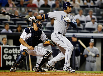 NEW YORK - SEPTEMBER 23: Carl Crawford ##13 of the Tampa Bay Rays grounds out in the first-inning against the New York Yankees on September 23, 2010 at Yankee Stadium in the Bronx borough of New York City.  (Photo by Mike Stobe/Getty Images)