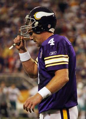 MINNEAPOLIS - SEPTEMBER 19:  Quarterback Brett Favre #4 of the Minnesota Vikings walks off the field after failing to make a first down during the second half of the game against the Miami Dolphins on September 19, 2010 at Hubert H. Humphrey Metrodome in