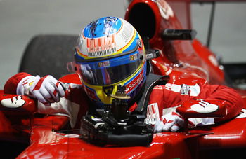 SINGAPORE - SEPTEMBER 26:  Fernando Alonso of Spain and Ferrari celebrates in parc ferme after winning the Singapore Formula One Grand Prix at the Marina Bay Street Circuit on September 26, 2010 in Singapore.  (Photo by Paul Gilham/Getty Images)