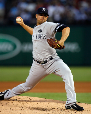 ARLINGTON, TX - SEPTEMBER 10:  Starting pitcher Javier Vasquez #31 of the New York Yankees pitches against the Texas Rangers on September 10, 2010 at Rangers Ballpark in Arlington, Texas.  (Photo by Tom Pennington/Getty Images)