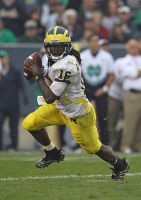 SOUTH BEND, IN - SEPTEMBER 11: Denard Robinson #16 of the Michigan Wolverines rolls out to look for a receiver against the Notre Dame Fighting Irish at Notre Dame Stadium on September 11, 2010 in South Bend, Indiana. Michigan defeated Notre Dame 28-24. (P
