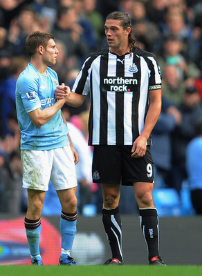 MANCHESTER, ENGLAND - OCTOBER 03: Andy Carroll of Newcastle shakes hands with James Milner of Manchester City after the Barclays Premier League match between Manchester City and Newcastle United at the City of Manchester Stadium on October 3, 2010 in Manc