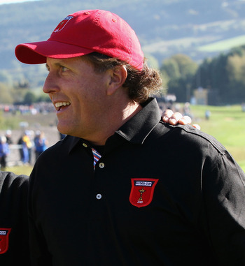 NEWPORT, WALES - OCTOBER 04:  USA Team Captain Corey Pavin (L) greets Phil Mickelson on the first tee in the singles matches during the 2010 Ryder Cup at the Celtic Manor Resort on October 4, 2010 in Newport, Wales.  (Photo by David Cannon/Getty Images)