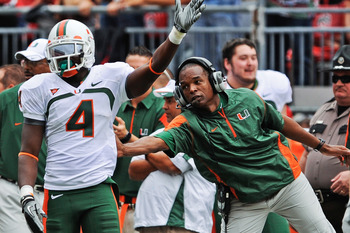 COLUMBUS, OH - SEPTEMBER 11:  Head Coach Randy Shannon of the Miami Hurricanes congratulates Aldarius Johnson #4 of the Hurricanes after a first down catch against the Ohio State Buckeyes at Ohio Stadium on September 11, 2010 in Columbus, Ohio.  (Photo by