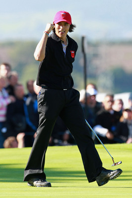 NEWPORT, WALES - OCTOBER 04:  Rickie Fowler of the USA celebrates on the 18th green after halving his match in the singles matches during the 2010 Ryder Cup at the Celtic Manor Resort on October 4, 2010 in Newport, Wales.  (Photo by Andrew Redington/Getty