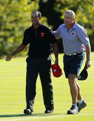 NEWPORT, WALES - OCTOBER 04:  Tiger Woods of the USA with his caddie Steve Williams on the 15th green in the singles matches during the 2010 Ryder Cup at the Celtic Manor Resort on October 4, 2010 in Newport, Wales.  (Photo by Andrew Redington/Getty Image