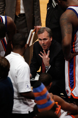 NEW YORK - OCTOBER 24:  Head coach Mike D'Antoni of the New York Knicks speaks to his team during a timeout in the second half of a pre-season game against the New Jersey Nets on October 24, 2008 at Madison Square Garden in New York City. The Nets won 111