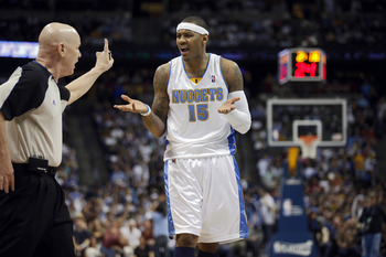 DENVER, CO - APRIL 17 : Carmelo Anthony #15 of the Denver Nuggets argues a call and gets hit with a technical foul by referee Joey Crawford during the first half of Game One of the Western Conference Quarterfinals against the Utah Jazz in the 2010 NBA Pla
