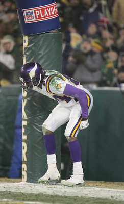 GREEN BAY, WI - JANUARY 9:  Wide receiver Randy Moss #84 of the Minnesota Vikings pretends to moon the crowd after scoring a touchdown against the Green Bay Packers in the NFC wild-card game at Lambeau Field on January 9, 2005 in Green Bay, Wisconsin. The