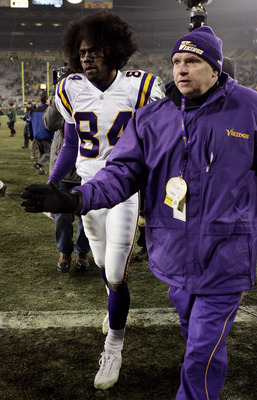 GREEN BAY, WI - JANUARY 9:  Wide receiver Randy Moss #84 of the Minnesota Vikings is escorted off the field after the Vikings defeated the Green Bay Packers during the NFC wild-card game at Lambeau Field January 9, 2005 in Green Bay, Wisconsin. The Viking