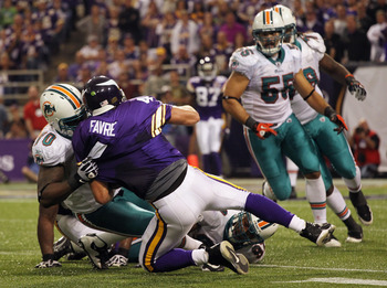 MINNEAPOLIS - SEPTEMBER 19:  Quarterback Brett Favre #4 of the Minnesota Vikings is sacked by Kendall Langford #70 of the Miami Dolphins during the second half of the game on September 19, 2010 at Hubert H. Humphrey Metrodome in Minneapolis, Minnesota.  (