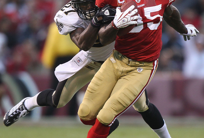 SAN FRANCISCO - SEPTEMBER 20:  Vernon Davis #85 of the San Francisco 49er runs after a catch against Malcolm Jenkins #27 of the New Orleans Saints during an NFL game at Candlestick Park on September 20, 2010 in San Francisco, California.(Photo by Jed Jaco