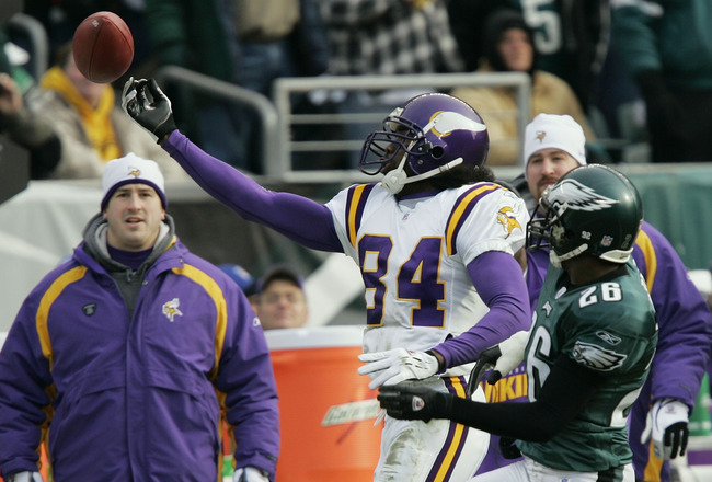 PHILADELPHIA - JANUARY 16:  Wide receiver Randy Moss #84 of the Minnesota Vikings reaches out with one hand to try and catch a pass against the defense of cornerback Lito Sheppard #26 of the Philadelphia Eagles in an NFC divisional playoff game at Lincoln