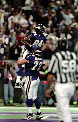 10 Jan 1999:  Randy Moss #84 of the Minnesota Vikings celebrates with teammate Todd Steussie #73 after scoring a touch down during the NFC Play Off Game against the Arizona Cardinals at the HHH Metrodome in Minneapolis, Minnesota. The Vikings defeated the