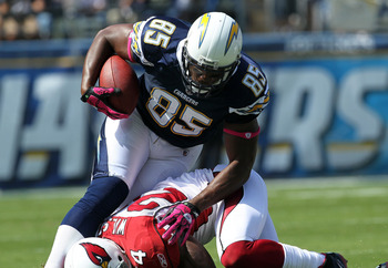 SAN DIEGO - OCTOBER 03:  Tight end Antonio Gates #85 of the San Diego Chargers carries the ball against safety Adrian Wilson #24 of the Arizona Cardinals at Qualcomm Stadium on October 3, 2010 in San Diego, California.  (Photo by Stephen Dunn/Getty Images