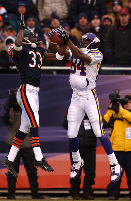 CHICAGO - DECEMBER 14: Cornerback Charles Tillman #33 of the Chicago Bears takes the ball away from receiver Randy Moss #84 of the Minnesota Vikings on a pass in the end zone during a game on December 14, 2003 at Soldier Field in Chicago, Illinois. The Be