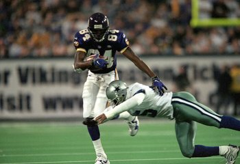 8 Nov 1999:  Randy Moss #84 of the Minnesota Vikings in action against Charlie Williams of the Dallas Cowboys at the Herbert H. Humphery Metrodome in Minneapolis, Minnesota. The Vikings defeated the Cowboys 27-17. Mandatory Credit: Elsa Hasch/Allsport