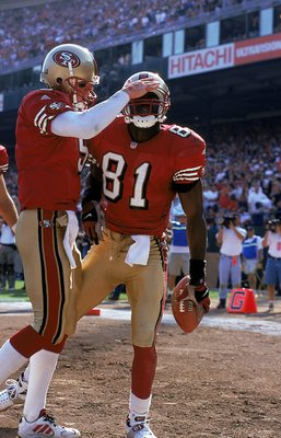 3 Oct 1999: Jeff Garcia #5 of the San Francisco 49ers celebrates with teammate Terrell Owens #81 during a game against the Tennessee Titans at the 3Com Park in San Francisco, California. The 49ers defeated the Titans 24-22. Mandatory Credit: Jed Jacobsohn
