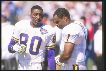18 Sep 1994:  Wide receiver Cris Carter (left) and quarterback Warren Moon of the Minnesota Vikings speak on the sideline during a game against the Chicago Bears at Soldier Field in Chicago, Illinois.  The Vikings won the game 42-14. Mandatory Credit: Jon