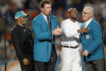 MIAMI - DECEMBER 15:  Former Miami Dolphins Quarterback Dan Marino (2nd-L) inducts into the Miami Dolphins Hall of Fame Mark Clayton (L) and Mark Duper with the help of Coach Don Shula (R) during half time against the Philadelphia Eagles on December 15, 2