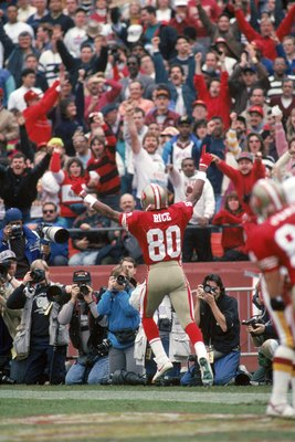 SAN FRANCISCO - JANUARY 12:  Wide receiver Jerry Rice #80 of the San Francisco 49ers celebrates a 10-yard touchdown pass from Joe Montana in the second quarter in the 1990 NFC Divisional Playoff game against the Washington Redskins at Candlestick Park on
