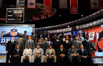 NEW YORK - APRIL 22:  2010 NFL Draft prospects pose for a group photo with NFL Commissioner Roger Goodell along with former and current NFL Players including Jim Brown, Jerry Rice, Dan Marino, Lawrence Taylor, Deion Sanders, Barry Sanders, Joe Montana, Fl