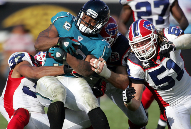 JACKSONVILLE, FL - NOVEMBER 22:  Running back  Maurice Jones Drew #32 of the Jacksonville Jaguars  is brought down by defenders of the Buffalo Bills at Jacksonville Municipal Stadium on November 22, 2009 in Jacksonville, Florida. Jacksonville defeated Buf