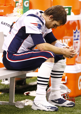 NEW ORLEANS - NOVEMBER 30: Quarterback Tom Brady #12 of the New England Patriots sits dejected on the bench late in the fourth quarter against the New Orleans Saints at Louisana Superdome on November 30, 2009 in New Orleans, Louisiana. (Photo by Scott Hal