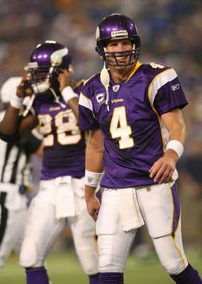 MINNEAPOLIS - NOVEMBER 22:  Brett Favre #4 of the Minnesota Vikings smiles as he walks from the field against the Seattle Seahawks at Hubert H. Humphrey Metrodome on November 22, 2009 in Minneapolis, Minnesota.  (Photo by Nick Laham/Getty Images)