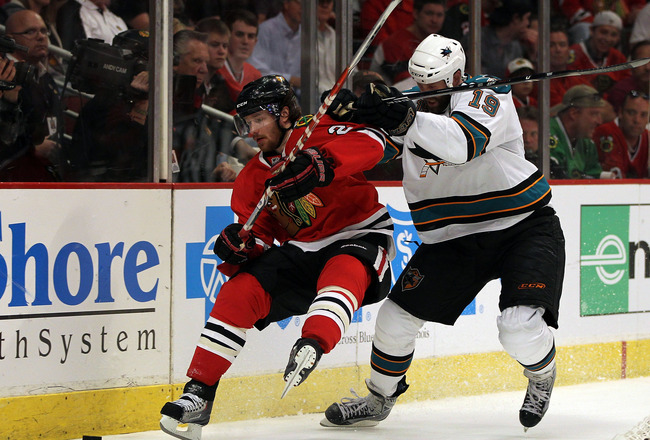 CHICAGO - MAY 23: Joe Thornton #19 of the San Jose Sharks checks Duncan Keith #2 of the Chicago Blackhawks in the second period of Game Four of the Western Conference Finals during the 2010 NHL Stanley Cup Playoffs at the United Center on May 23, 2010 in