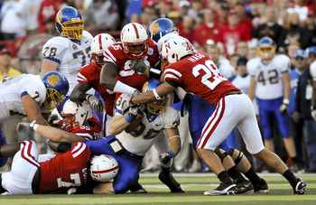 LINCOLN, NEBRASKA - SEPTEMBER 25: The Nebraska Cornhusker defense swarms South Dakota State Jackrabbits running back Kyle Minett #30 during first half action of their game at Memorial Stadium on September 25, 2010 in Lincoln, Nebraska. Nebraska Defeated S