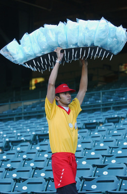 ANAHEIM, CA - AUGUST 29:  Cotton Candy vendor Nick Negron carries his candy in front of empty seats on the eve of a Major League Baseball strike before the game between the Tampa Bay Devil Rays and the Anaheim Angels at Edison Field on August 29, 2002 in