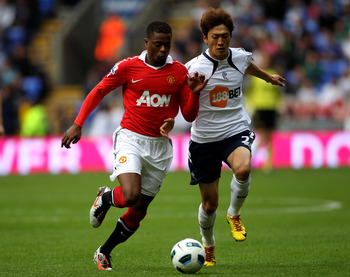 BOLTON, ENGLAND - SEPTEMBER 26:  Chung Yong Lee of Bolton Wanderers competes with Patrice Evra of Manchester United during the Barclays Premier League match between Bolton Wanderers and Manchester United at the Reebok Stadium on September 26, 2010 in Bolt