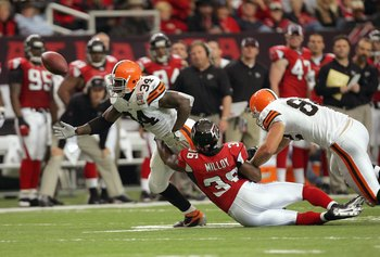 ATLANTA - NOVEMBER 12: Lawyer Milloy #36  of the Atlanta Falcons grabs Reuben Droughns #34 of the Cleveland Browns at the Georgia Dome November 12, 2006 in Atlanta, Georgia. (Photo by Streeter Lecka/Getty Images)
