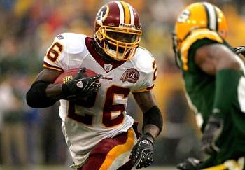 GREEN BAY, WI - OCTOBER 14:  Clinton Portis #26 of the Washington Redskins carries the ball against against the Green Bay Packers October 14, 2007 at Lambeau Field in Green Bay, Wisconsin.  (Photo by Matthew Stockman/Getty Images)