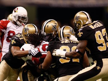 NEW ORLEANS - JANUARY 16:  The New Orleans Saints make a defensive stop against the Arizona Cardinals during the NFC Divisional Playoff Game at Louisana Superdome on January 16, 2010 in New Orleans, Louisiana. The Saints won 45-14. (Photo by Chris Graythe