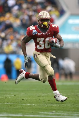 JACKSONVILLE, FL - JANUARY 01:  Running back Jermaine Thomas #38 of the Florida State Seminoles looks for room to run against the West Virginia Mountaineers during the Konica Minolta Gator Bowl on January 1, 2010 at Jacksonville Municipal Stadium in Jacks