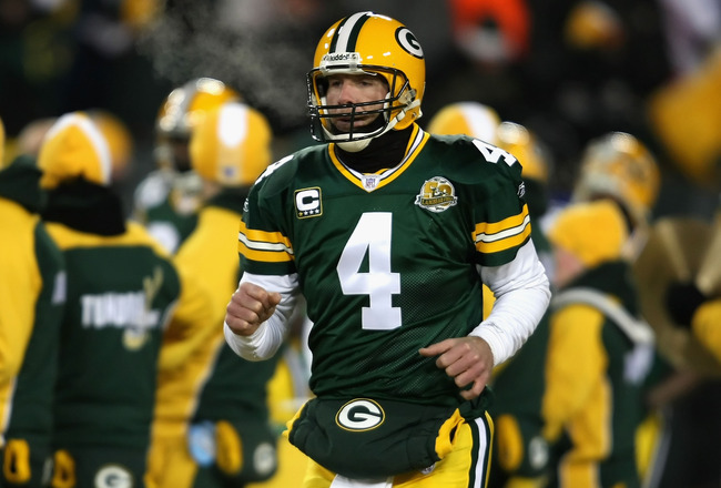 GREEN BAY, WI - JANUARY 20:  Quarterback Brett Favre #4 of the Green Bay Packers runs out onto the field before the NFC championship game against the New York Giants on January 20, 2008 at Lambeau Field in Green Bay, Wisconsin.  (Photo by Jonathan Daniel/