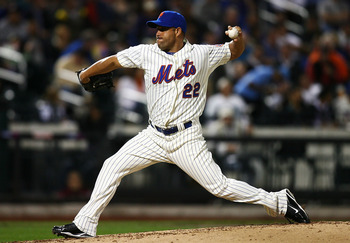 NEW YORK - SEPTEMBER 15:  Raul Valdes #22 of the New York Mets pitches against the Pittsburgh Pirates on September 15, 2010 at Citi Field in the Flushing neighborhood of the Queens borough of New York City.  (Photo by Andrew Burton/Getty Images)