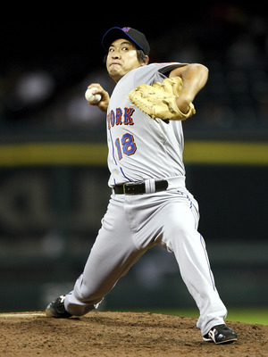 HOUSTON - AUGUST 19:  Pitcher Ryota Igarashi #18 of the New York Mets throws against the Houston Astros at Minute Maid Park on August 19, 2010 in Houston, Texas.  (Photo by Bob Levey/Getty Images)