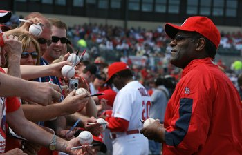 JUPITER, FL - MARCH 10:  Hall-of-Famer Bob Gibson of the St Louis Cardinals signs autographs for fans before taking on the Washington Nationals at Roger Dean Stadium on March 10, 2010 in Jupiter, Florida.  (Photo by Doug Benc/Getty Images)